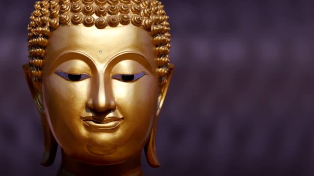 Golden Buddha statue close up ,Panning video