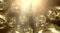 Golden Christmas balls with god light from above. video