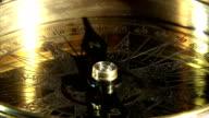 Golden compass closeup video