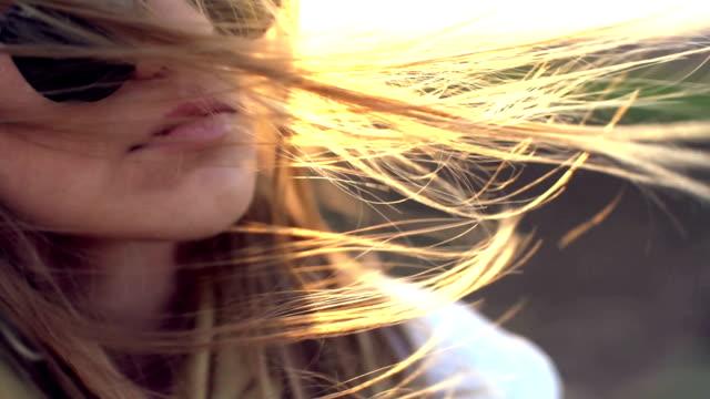 Golden hair and golden sunset video