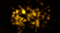 Golden particle seamless background with alpha channel. HD video
