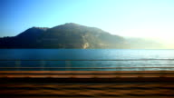 golden pass train travelling beside lake Thun video