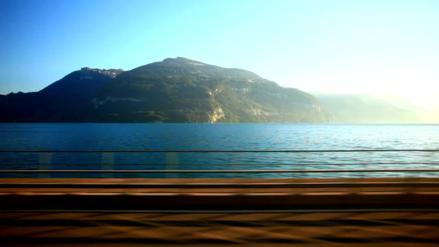 golden pass train travelling beside lake Thun video
