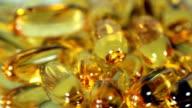 Golden Pills turning. HD video