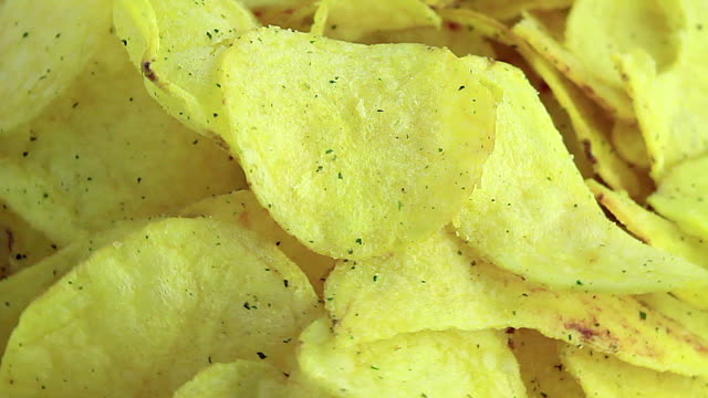 Golden potato chips sprinkled on the plate video