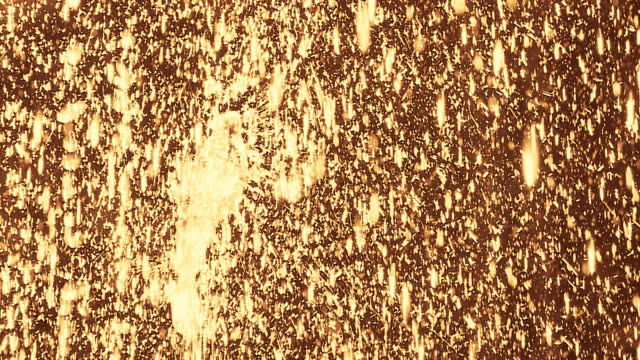 HD SLOW MOTION: Golden Sparkling Drops video