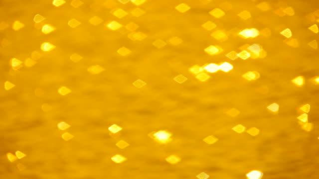 Golden sparkling water. video