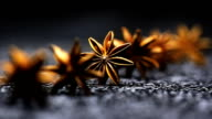 Golden Star Anise spice black background video