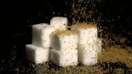 Golden sugar falling onto cubes video