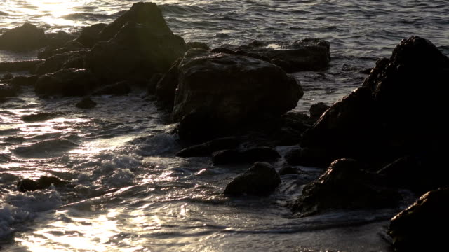 Golden Sunlight Reflecting on Ocean Surf video