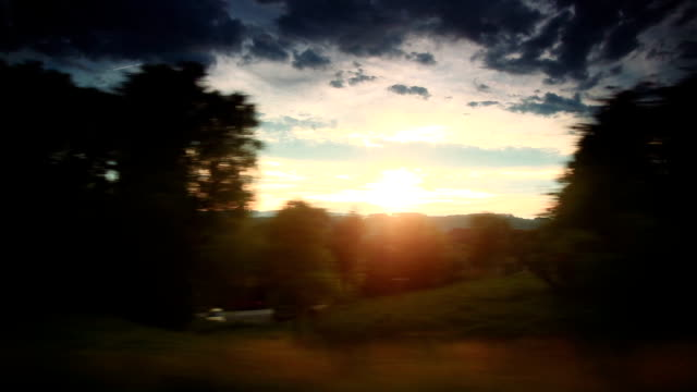 Golden sunrise by traveling train window video