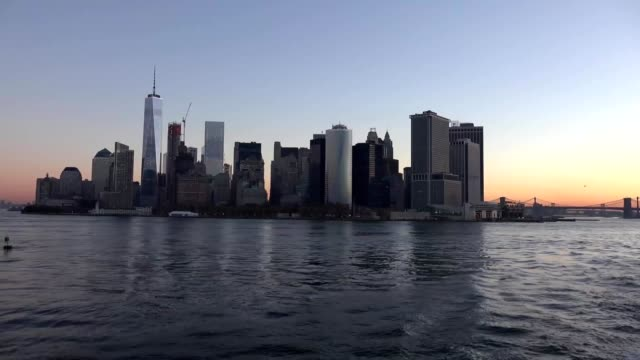 Golden sunset Manhattan Downtown panorama skyscrapers, New York City NYC Skyline. Apartments Buildings. The skyline of New York City at Sunset filmed from the the New Jersey. video