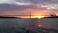 Golden sunset on the background of 25th April Bridge video