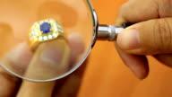 HD: Goldsmith inspecting precious diamond ring video
