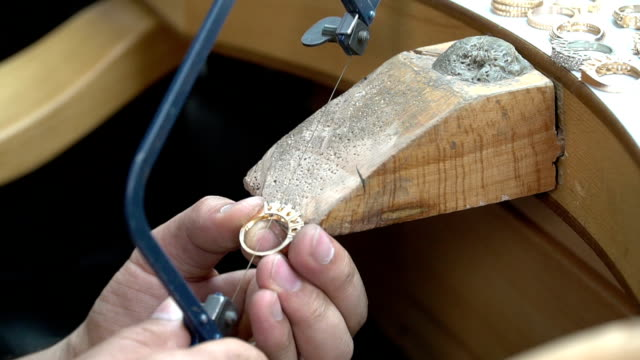 Goldsmith refines a silver or gold ring video