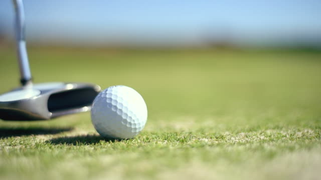 golf ball is hammered in the pocket video
