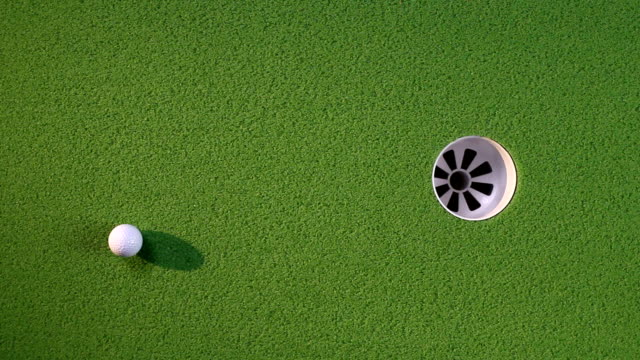 Golf ball rolls into cup video