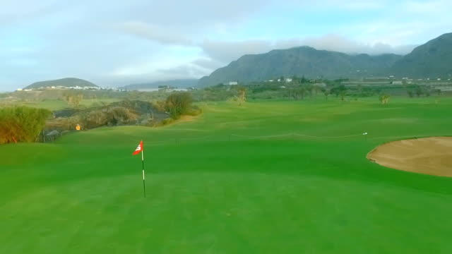 Golf Flag Blowing In Wind On Golf Course video