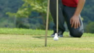 Golf player taking his putt on green golf course video