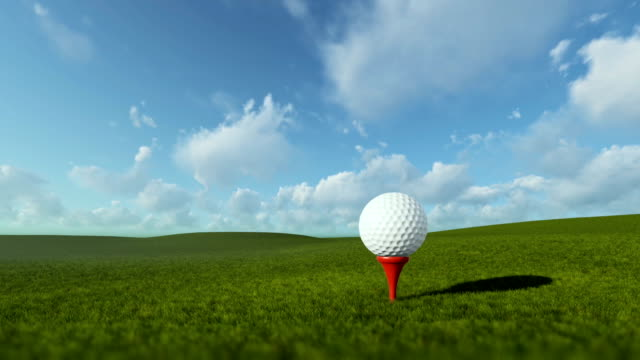 Golfball on tee against beautiful timelapse blue sky, panning video