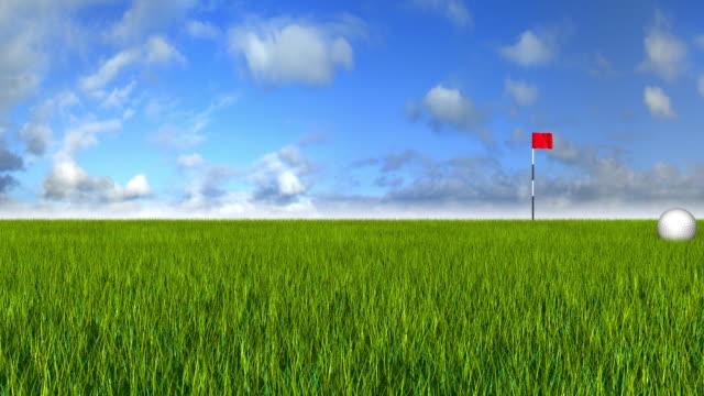 Golfball rolling on grass scene video