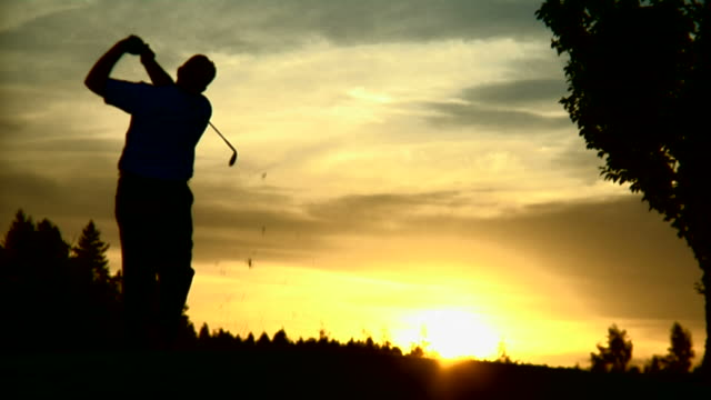 1080-P- golfer at sunset video