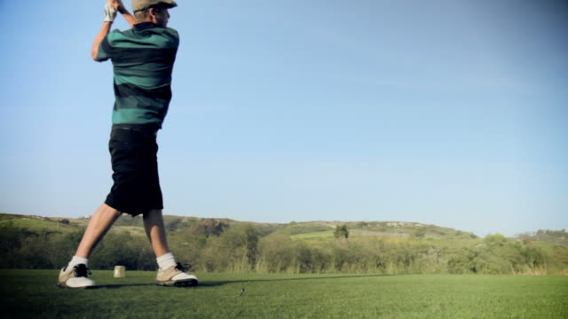 Golfer hits solid drive, shot in HD. video