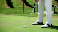 HD MACRO: Golfer hits the ball video