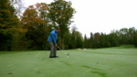 Golfer hitting ball from fairway video