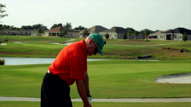 Golfer hurts his back during a golf swing. video