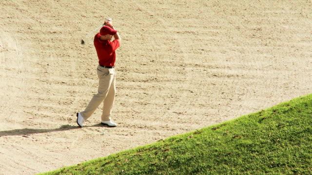 Golfer in a bunker video