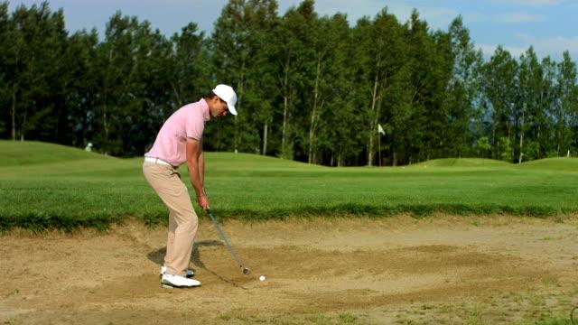 HD SLOW MOTION: Golfer Making A Bunker Shot video