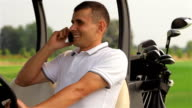 Golfer making a call outdoors video