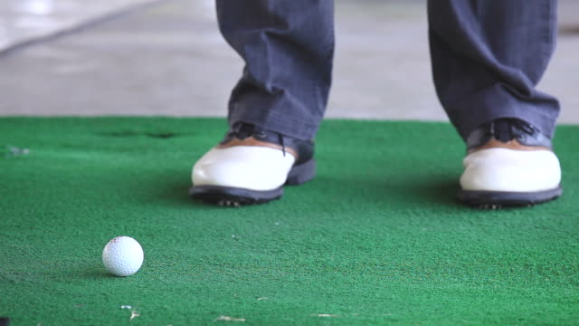 Golfer Practicing and training to Chip golf ball from fairway video