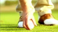 Golfer tees up ball video