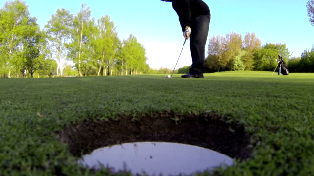 Golfers Putt From A Worms Eyed Perspective video