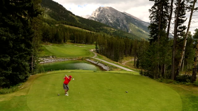 Golfers tee off on mountain course video
