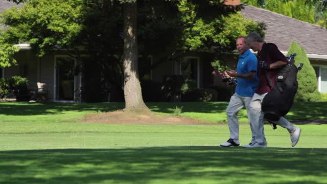 Golfers walk together. video