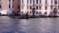 VENICE, ITALY. A gondola is rowed by a gondolier in romantic Venice, Italy. video