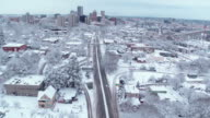 Gondolas crossing over a snow covered city video