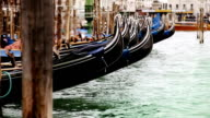 Gondolas rocking on the waves on the main 'parking' near Piazza San Marco in Venice, Italy video