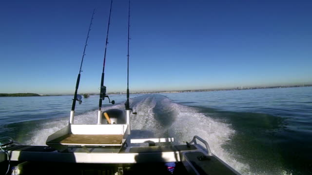 Gone fishing! Motor boat view looking back. video
