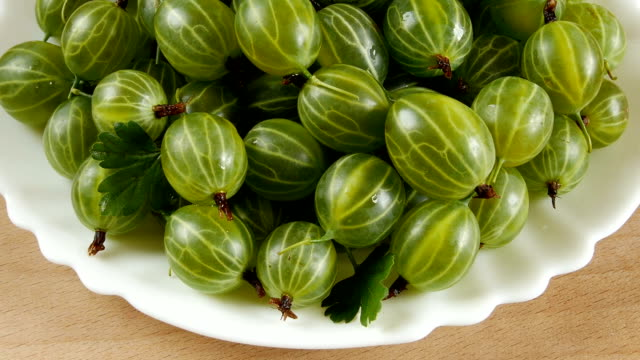Gooseberry in a plate on the table. video
