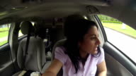 Gorgeous woman driver looking back and parking car video