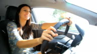 Gorgeous woman talking on the phone while driving car video