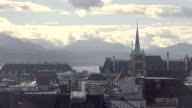 Gothic spire of Saint Francois Church, misty cityscape of Lausanne, Switzerland video