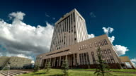Government Building against the blue sky and clouds, view from below. Kazakhstan - FullHD Timelapse video