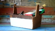 Grab the tools from the wooden toolbox video