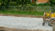 Grader Leveling Gravel On Road video