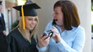 Graduate and mother take self portrait video